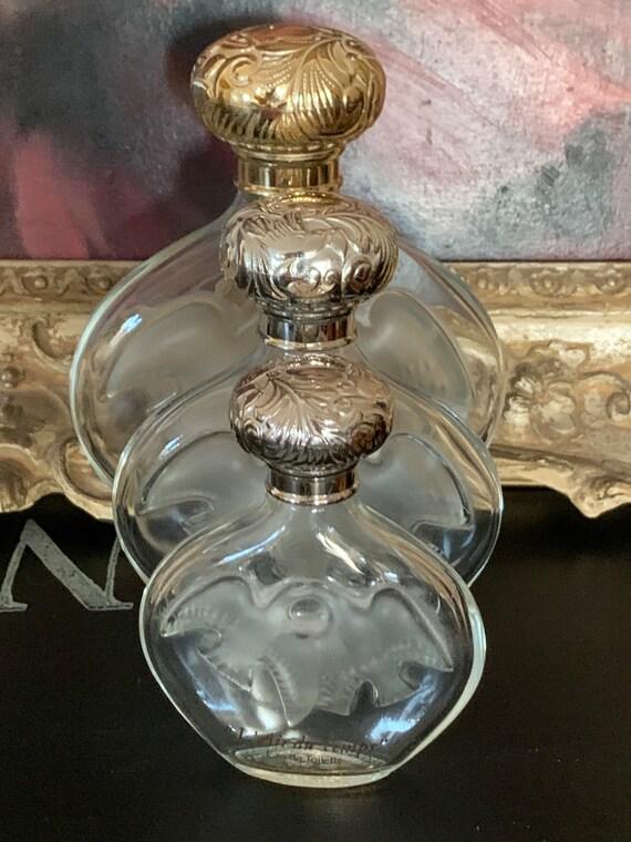 Three Graduating in size - Vintage Lalique Designed Perfume Bottles by Nina Ricci