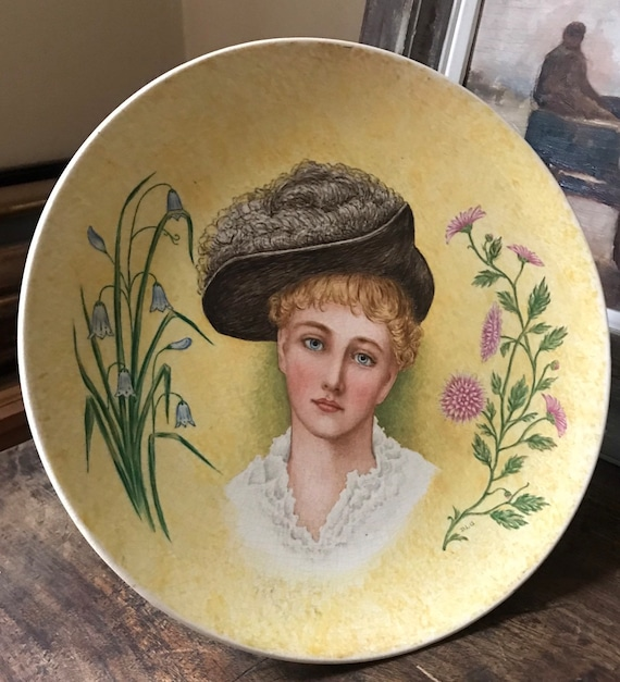 Beautiful Art Nouveau c1880's Handpainted Ceramic Plate Depicting Lady Wearing A Hat and Floral Decoration