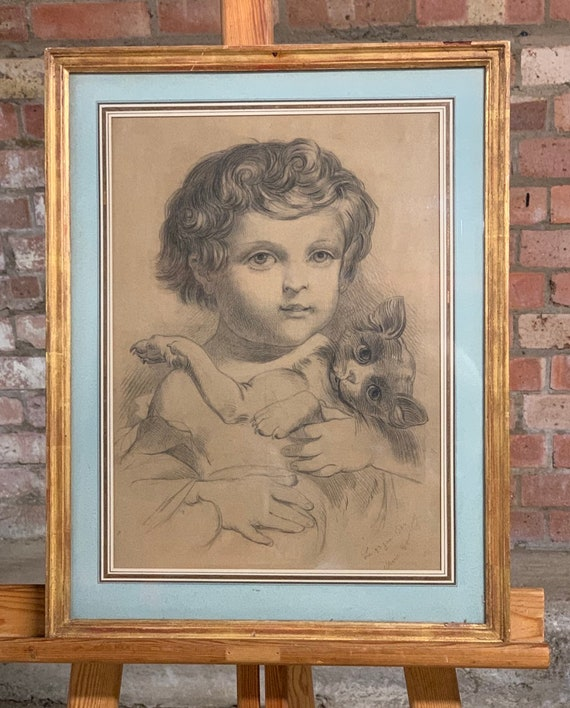 This is s Charming French 19th Century Framed Charcoal Drawing of a Cherub Like Child with a Kitten
