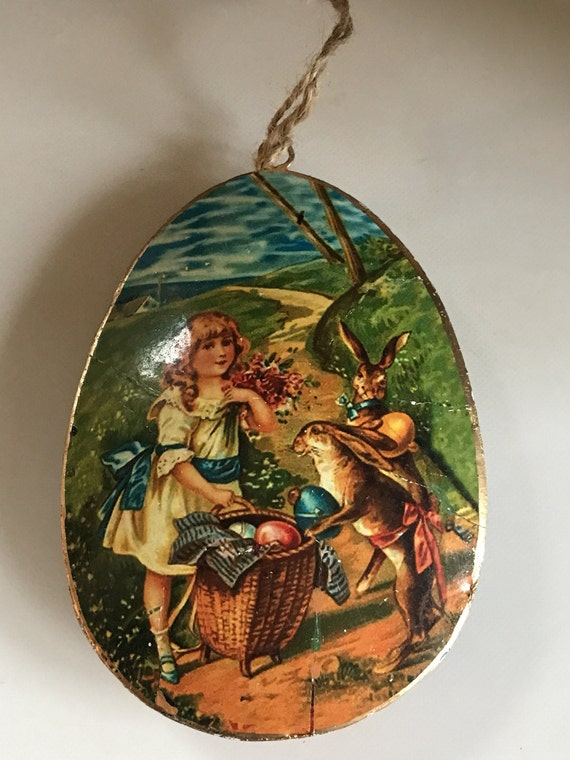 A Large Happy Easter Decoration with Print of a Young Girl with a Basket of Easter Eggs for the Easter Bunnies