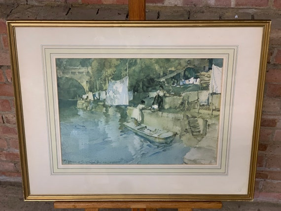 Sir William Russell Flint Print which is of two ladies by the River, Titled Riverside Washing, Lavardac, published by Adam Collection 1970
