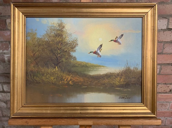 Lovely Vintage Gilt Wood Framed Oil Painting On Canvas Of Ducks Coming Into Land On The Pond at Sunset, signed Benson
