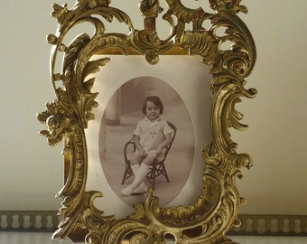 Bronze photo frame. Antique photo frame with a rocaille decor. Louis XV style.