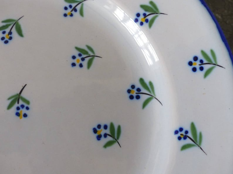 Cobalt blue flowers. French antique plate from the Restoration period 1830-1840 Lun\u00e9ville earthenware plate