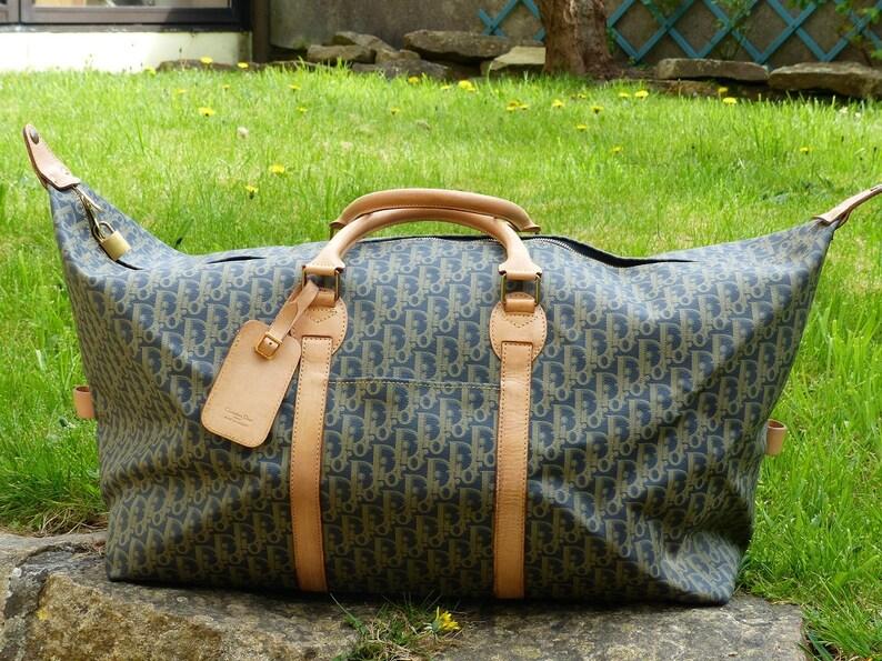 5ae94a2b321c Dior travel bag. Dior travel luggage. Dior weekend bag.