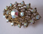 Vintage art deco style carnival glass brooch in gold setting from 1970s 1980s