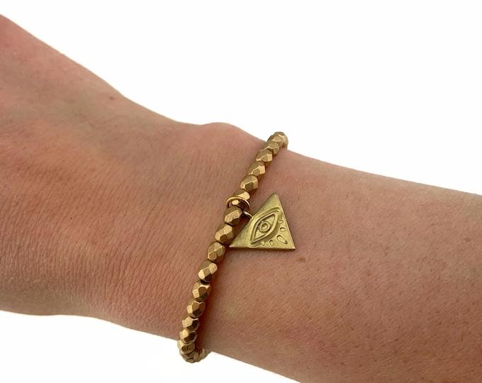 Matte Gold Czech Bead Bracelet with Evil Eye Charm