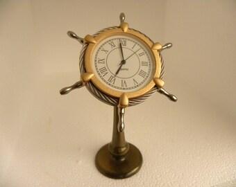vintage solid brass ships wheel clock by van cort inst.north hampton massachusetts