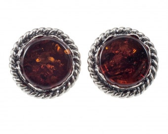 Round silver earrings of brown amber