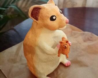 Hamster holding tiny Pomeranian