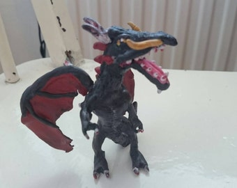 Dragon clay sculpture. Black and red