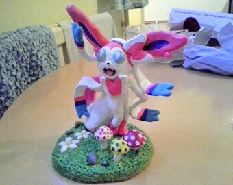 Sylveon pokemon made from super sculpey polymer clay. Handmade, painted with acrylic paint and glazed.
