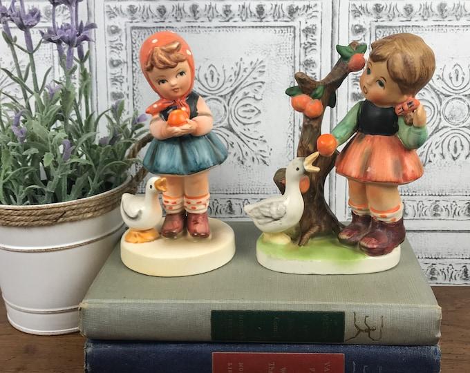 2 Vintage Hummel / Goebel Style Little Alpine Girl Figurines - Alpine Children with Geese & Oranges Statuettes - Farmhouse Nursery Decor