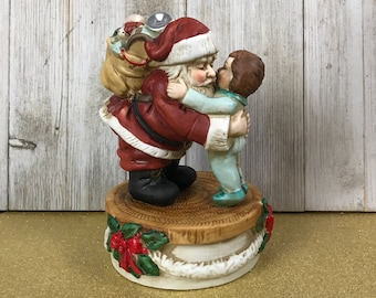 "Vintage Enesco Christmas Musical Figurine Santa Hugging Little Boy - 1983 Holiday Music Box Plays ""We Wish You A Merry Christmas"" Decoration"