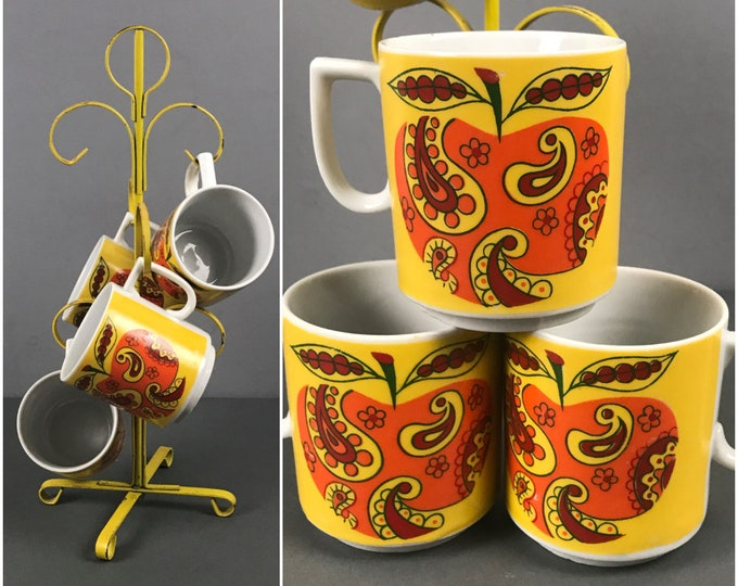 Featured listing image: Retro Yellow Mug Tree & 4 Psychedelic Coffee Cups - 1960's Decor Metal Cup Rack / Mugs Set - Groovy Orange Hippie Style Paisley Apple Design