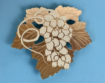 Large White Enamel & Brass Kitchen Trivet in Tuscan Grape Motif by William Rogers - Retro Coastal or Mediterranean Dining Room Table Staging