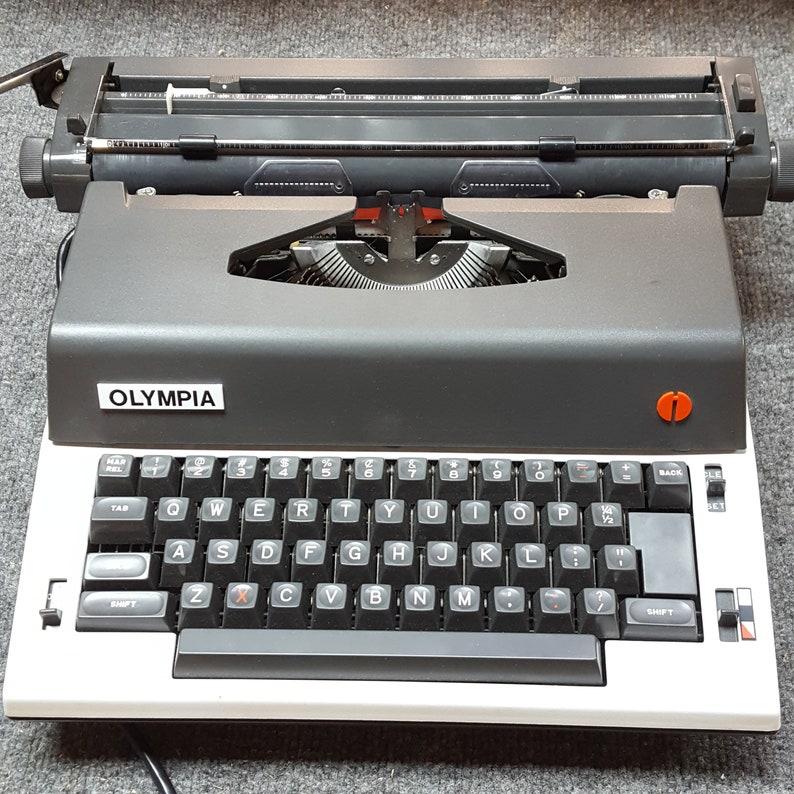FREE SHIPPING 1980s Olympia Electric M-R12 Typewriter Good image 0