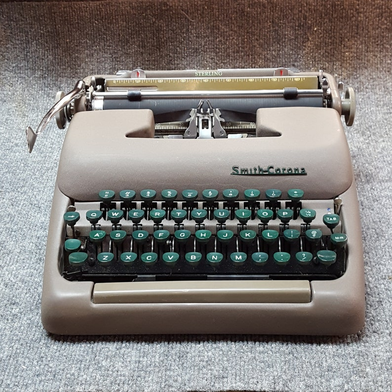FREE SHIPPING 1954 Smith Corona Sterling portable Typewriter image 0