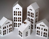 Pack of 5 DIY Putz style glitter houses. 6 quot - 11.8 quot tall unassembled corrugated cardboard houses. Make your own decorative house village