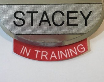 """SAMPLE Name tag add-ons   Name tag not included   Assorted styles for 2.5"""" oval name tags - Name tag NOT included."""
