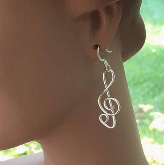Items similar to Silver Clef Note Earrings on Etsy