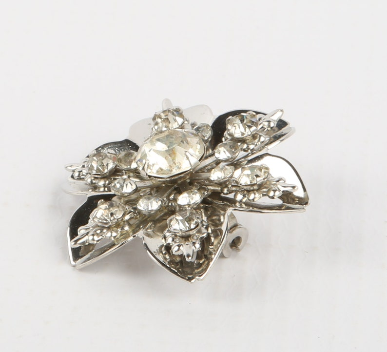Excellent Cond. Swedged Snowflake Brooch 1-38 Diameter Rhinestone Snowflake Silver Tone Rhinestones Roll Over Clasp No Maker Mark