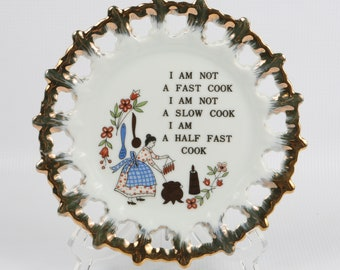 1950's-60's Brinn's Kitchen Wall Plate, Quaint Cook Pome. Graphic on Reticulated edge Gold Trim. Near MINT Condition. Hanger on Back.