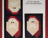 Ho Ho Ho pattern for a Santa wall quilt table runner designed by Cheryl Haynes for Prairie Grove Peddler 343 (2003) K3223