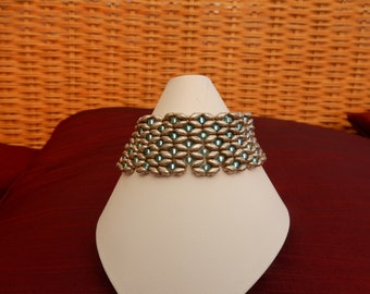 bracelet made with silver super duo and turquise seed beads and a silver metal magnetic clasp