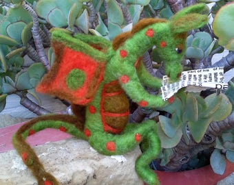 RAYMOND a  friendly green needle felted Dragon reading the paper.
