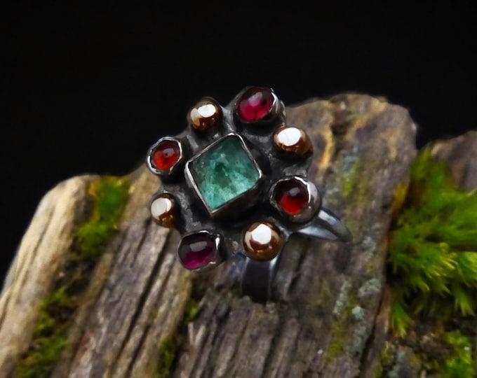 Emerald and Garnet Halo Ring