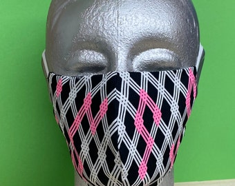 reusable and washable cotton mask with neon geometric shapes, with adjustable straps and nose bracket for optimal wearing comfort.