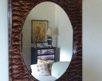 Oval mirror vinegar painted in walnut.