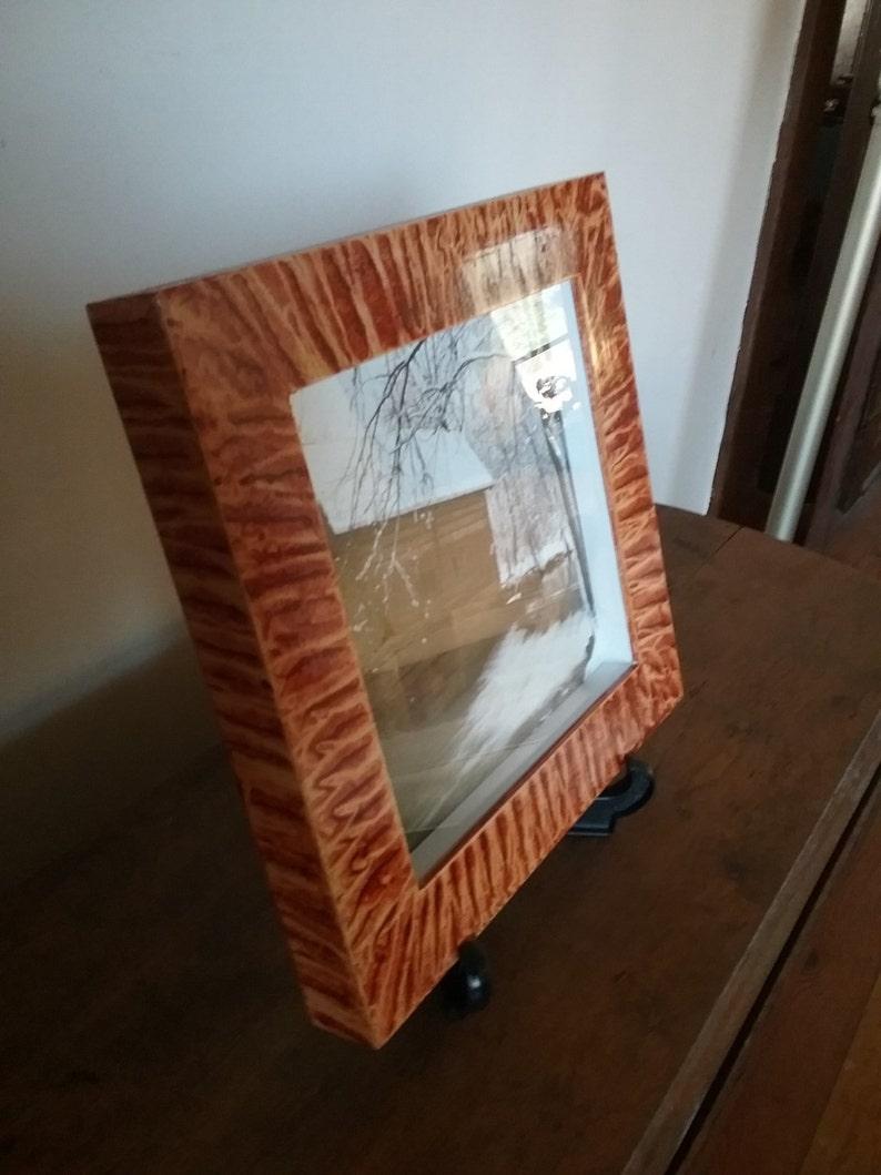 Shadowbox frame vinegar painted in coppery sienna