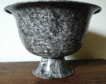 Metal urn vinegar painted in black and white