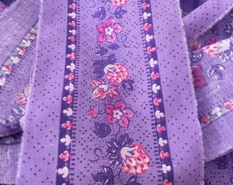French fabric remnant in a pretty soft lilac floral cotton, 9.16 metres in length x 8 cm wide.