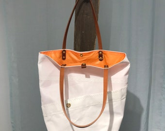 Sail cloth purse, four pocket, harness leather handle, tangerine colored interior