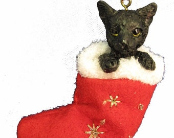 """Black cat Christmas ornament, handpainted and handcrafted. Measures 4"""" tall x 2"""" wide."""