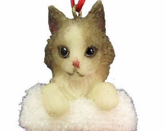 """Calico Cat Christmas ornament, handpainted and handcrafted. Measures 4"""" tall x 2"""" wide."""