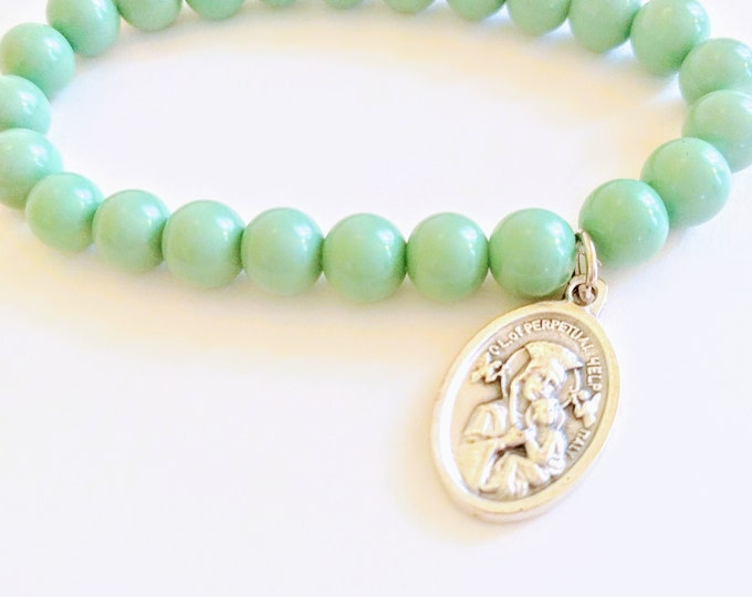 Featured listing image: Saint Gerard Bead Bracelet| Turquoise Glass Beads| Patron Saint of Pregnancy| Conception| Safe Child Birth| Young Children| Unborn| Mom Gift