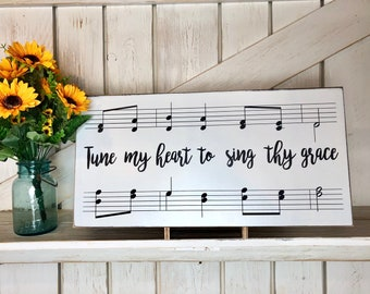 Tune my heart to sing thy grace sign  Old Hymn