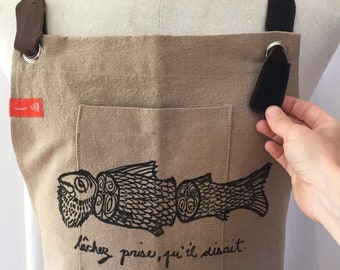 Men's apron in beige cotton, removable cross-straps on leather, durable hand print