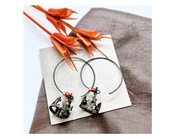 hoop earrings with crowns