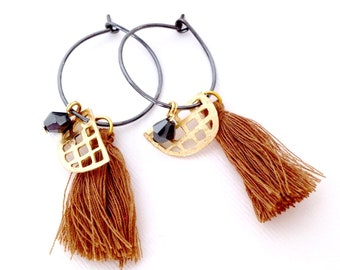 silver hoop earrings with cotton tassels and gold charms