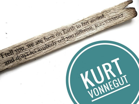 "Large Kurt Vonnegut driftwood engraving: ""...we are here on earth to fart around..."""