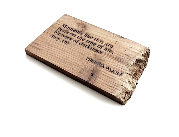 "Virginia Woolf quote ""moments like this are buds on the tree of life"" engraved on reclaimed redwood."