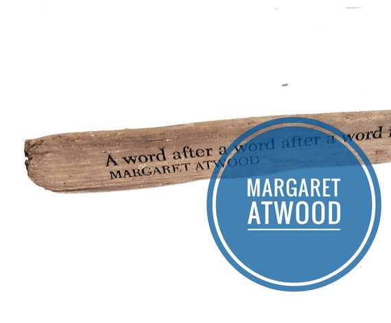 "Margaret Atwood ""A word after a word after a word is power"". Driftwood engraving"