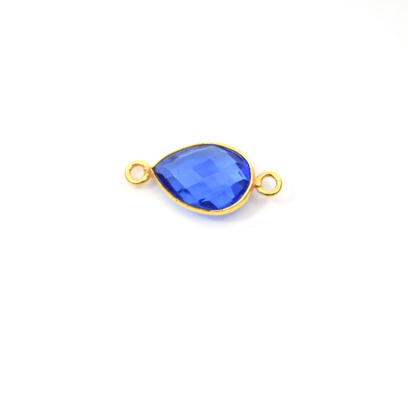 Measuring 9mm x 13mm Gold Plated Faceted Hydro Sold Individually Lab Created Transparent Cobalt Teardrop Shaped Bezel Connector