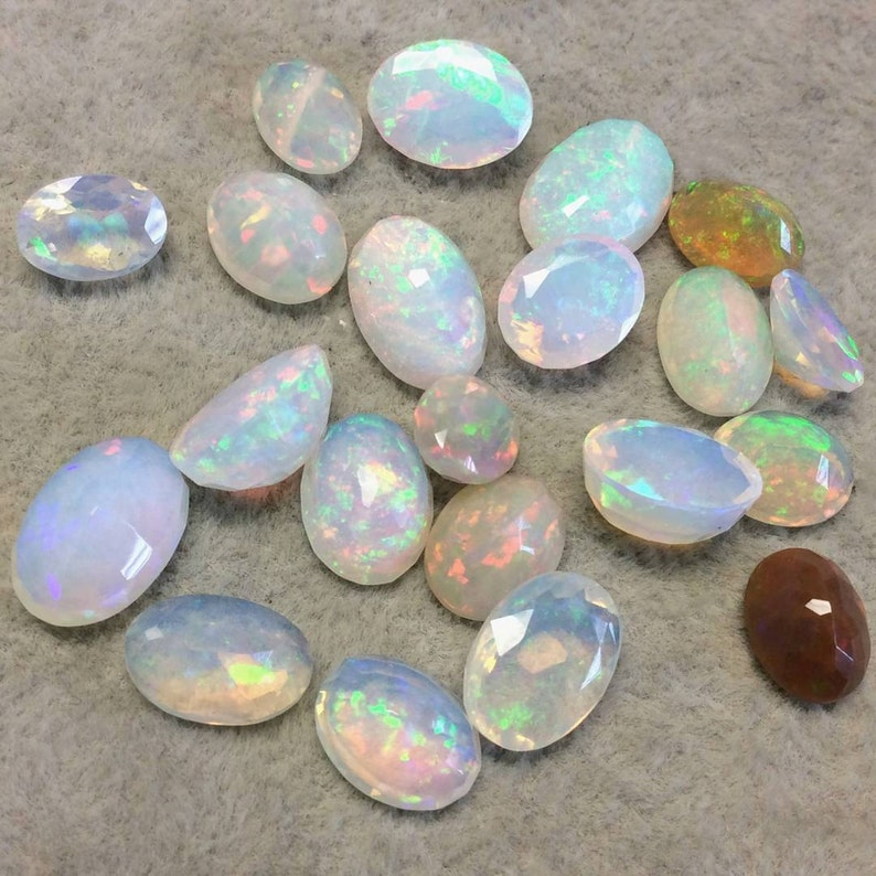and 1mm Crown Top 1.435 Carat Faceted Genuine Ethiopian Opal Oval Cut Stone F-E Base Measuring 7.5mm x 11mm with 3.5mm Pavillion