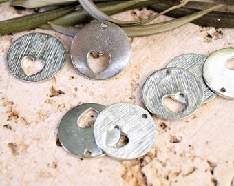 Round sequins with hollow heart silver metal 20 mm